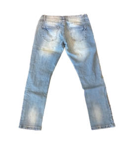 Jeans trousers with holes and tears
