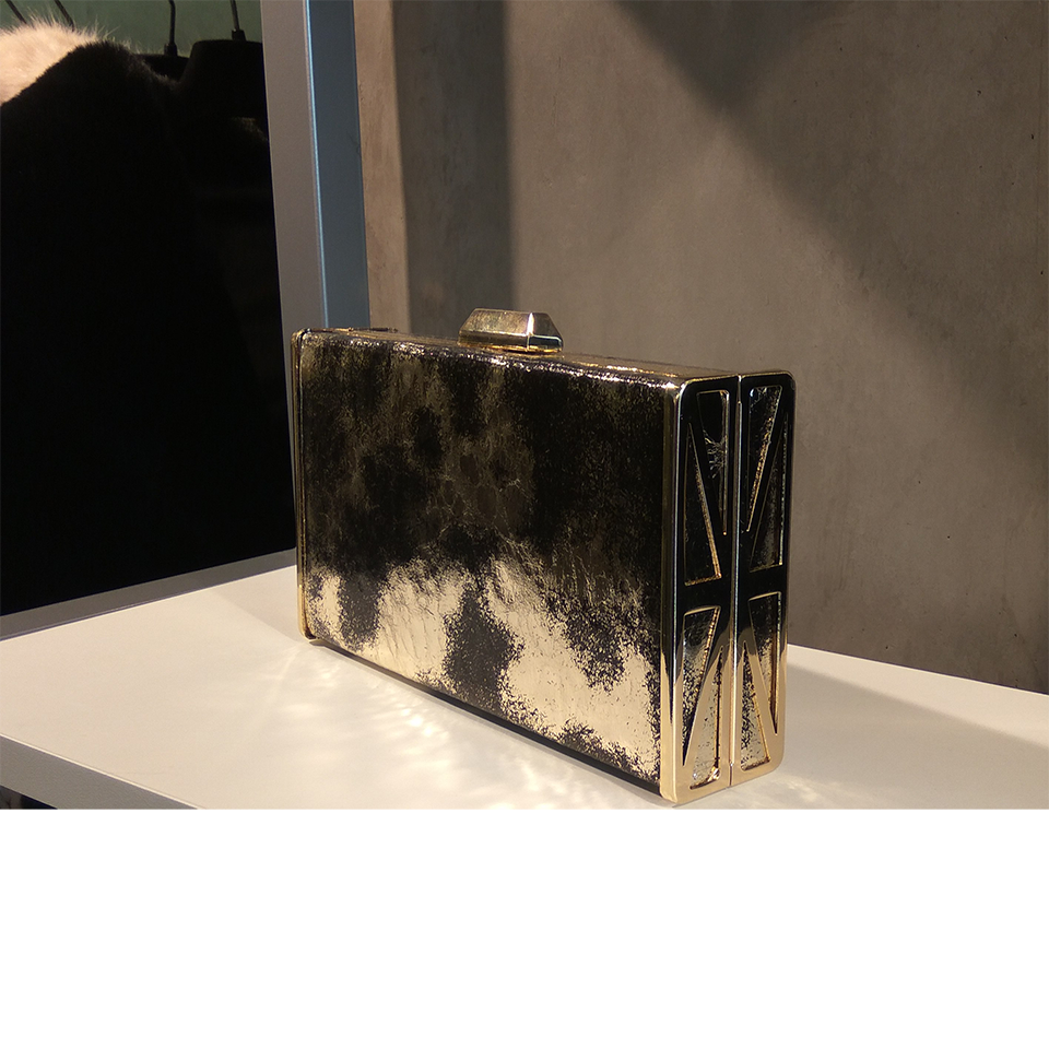 Female gold clutch bag with black