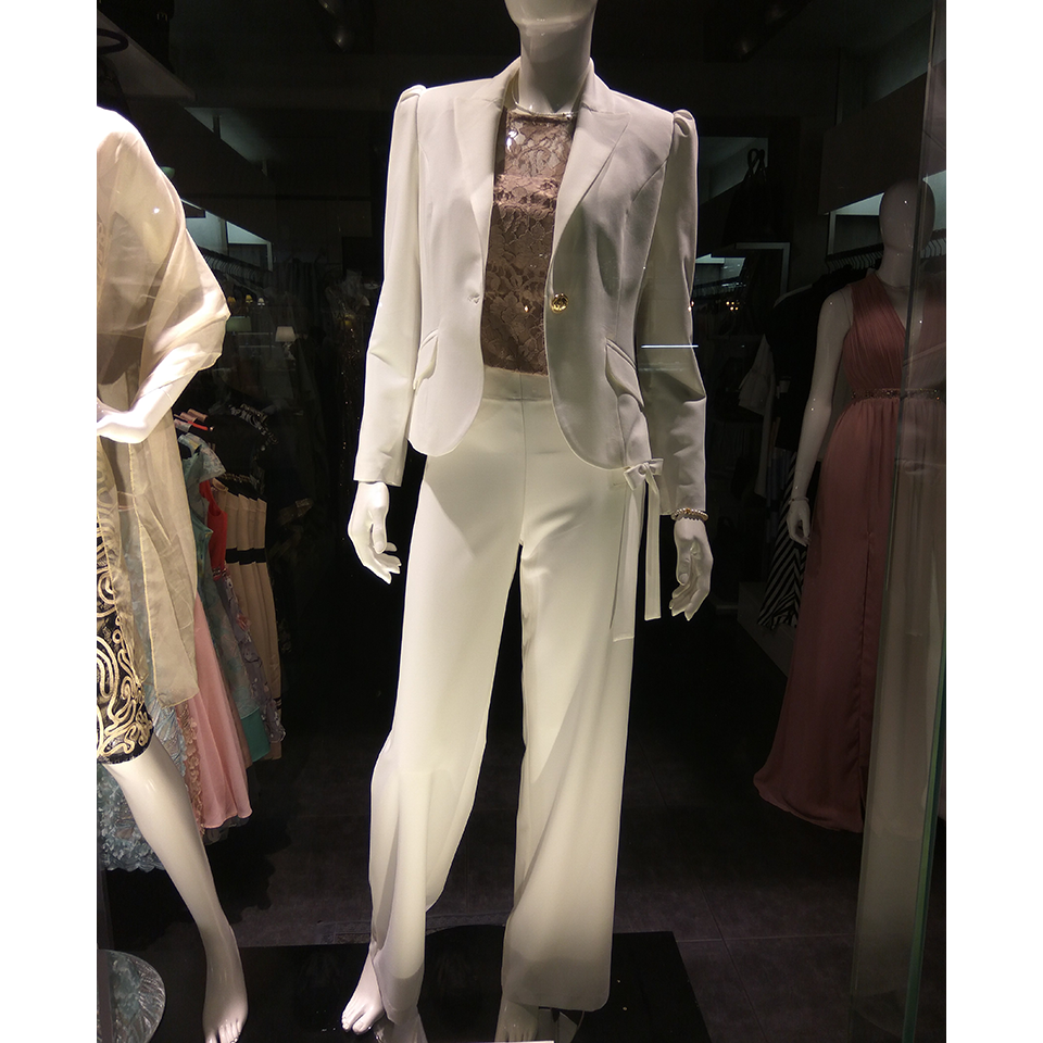 Female white pants with gold detail