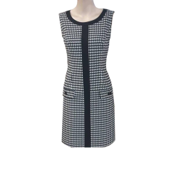 Short black and white dress with decorative pockets