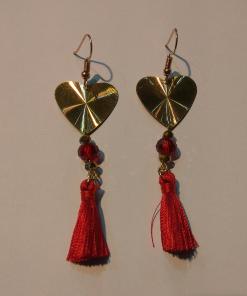 Short gold earrings with red tassel