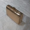 Small gold clutch bag